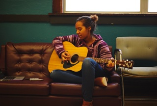 320 Imani on guitar